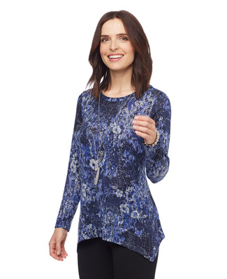 Woman in petite blue floral sharkbite hem sweater