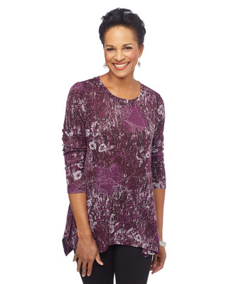 Woman in wine floral sharkbite hem top