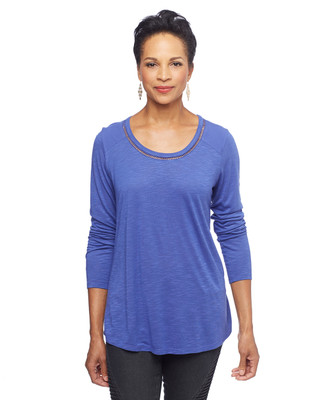 Woman in blue knit tunic
