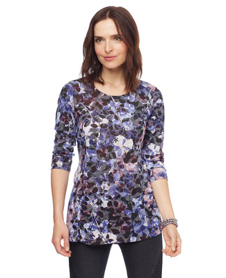 Woman in printed crewneck blouse