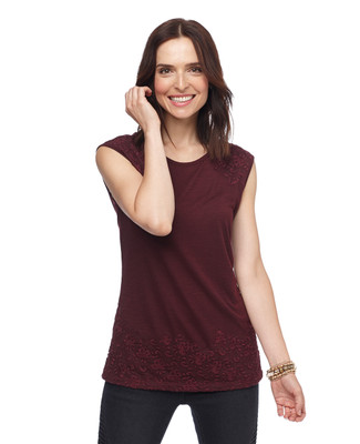 Woman in claret sleeveless embroidered tunic