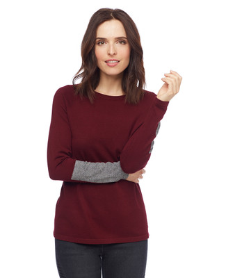Woman in wine colour block pullover sweater