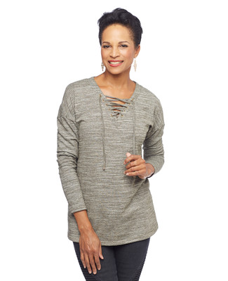 Woman in loden lace up tunic sweater