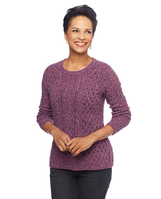 Woman in cable knit pointelle sweater