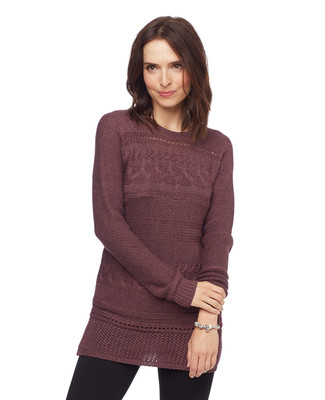 Woman in long black cable knit sweater