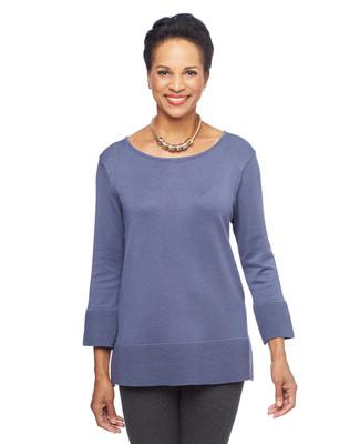 Woman in purple ribbed trim tunic sweater