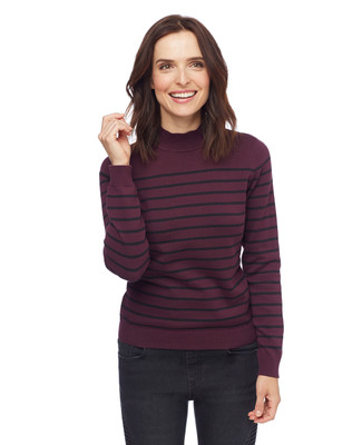 Woman in purple striped mock neck sweater