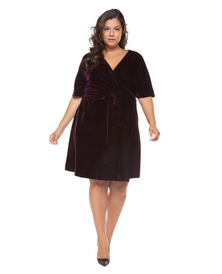 Women's plus size purple velvet wrap dress.