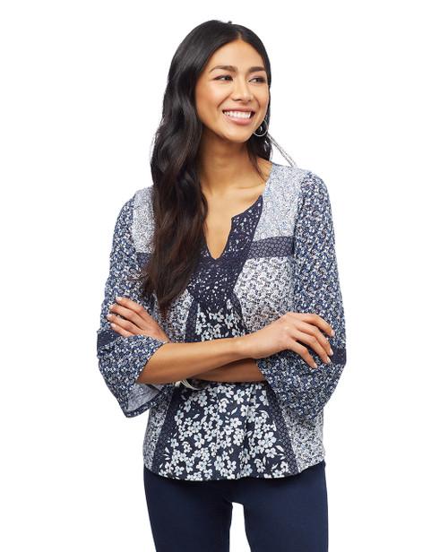Women's petite nile blue mix media blouse.