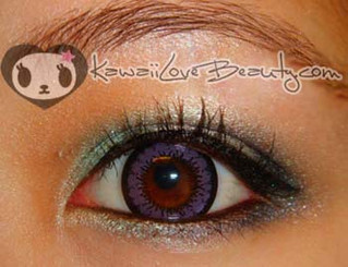 CM831 Geo Magic Color Angel Violet contact lens closeup on dark colored eye.