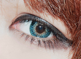 Closeup of Geo Twins Aqua Blue YH302 opaque soft colored contact lenses.