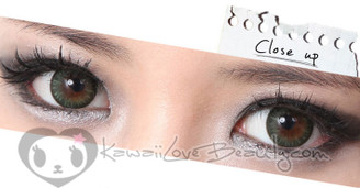 Closeup on brown eyes, Geo BS203 Bella Green soft colored contact lenses.