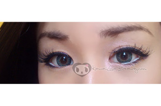 Closeup of Geo Berry Holic Turquoise CM-957 14.2mm circle lenses on brown eyes.