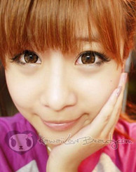 Plum Brown circle lenses by GEO on model.