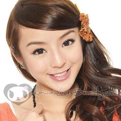 Model wears GEO Plum Brown 15mm diameter circle lenses.