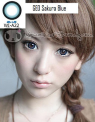 Geo Sakura Blue WIA22 circle lenses on model with brown eyes.