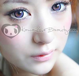 Sugar Candy violet circle lens on model with brown eyes in natural lighting.