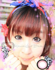 Pink circle lenses (EOS Sugar Candy) on model.