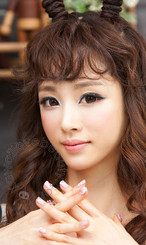 Pretty dolly look with eye enlarging Geo WTA-54 brown circle lenses.