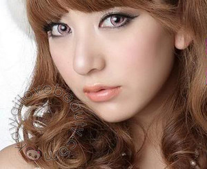 EOS Dolly Eye Blytheye Pink circle lenses on model.