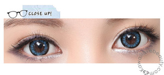 Closeup of Angel Blue circle lenses on dark colored eyes.