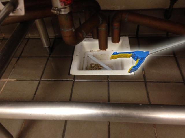 Hard to reach floor sink basket
