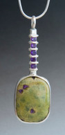 Faceted amethyst compliments this Sticktite pendant set in sterling silver, sold with a 16-inch sterling snake chain.