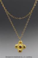Gold cross w/ tourmalines/ citrines/ garnet pendant