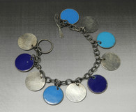 Shades of blue enamel on copper discs, sterling discs, sterling chain with toggle clasp charm bracelet.