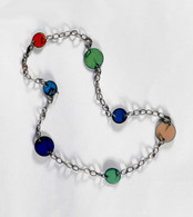 Multi colored and sized enamel on copper discs on oxidized silver chain with lobster clasp.  Approximately 16 inches long.