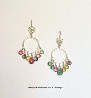 Sterling silver earrings with18k gold balls and  tourmalines.