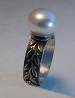 Sterling silver and pearl ring with a textured band