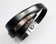 Leather wrap-around bracelet in black 10mm with etched silver and copper metal secured with brass and copper rivets. Bracelet wraps 3 times around wrist and has a silver plated magnetic clasp.