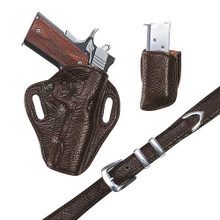 "Each Exotic Crosshair holster is leather lined and covered on both the front and the back with your choice of skins.  The holster features a tension screw and hand molding to bring out both the form of the gun and the beauty of the hide.  1 1/4"" Belt Flat-Black construction for all day comfort. Tension Screw Leather Lined"