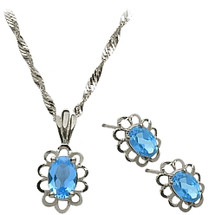 Sterling Silver Blue Topaz Oval Pendant & Earrings Set