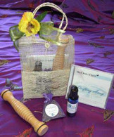 The Serenity gift bag contains Aromatherapy Massage/Body Oil Calming Balance, wooden massager,  relaxing CD and Lavender Sachet