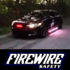 RED/WHITE FIRE ROCKER STROBE LIGHTS KIT MOUNTED ON A FORD TAURUS.