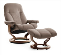 Medium Consul Stressless Recliner shown in Mole Batick Leather with Walnut wood.