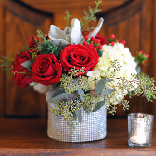 Send a little bling this holiday season with this arrangement of Roses, Hydrangea & Berries.