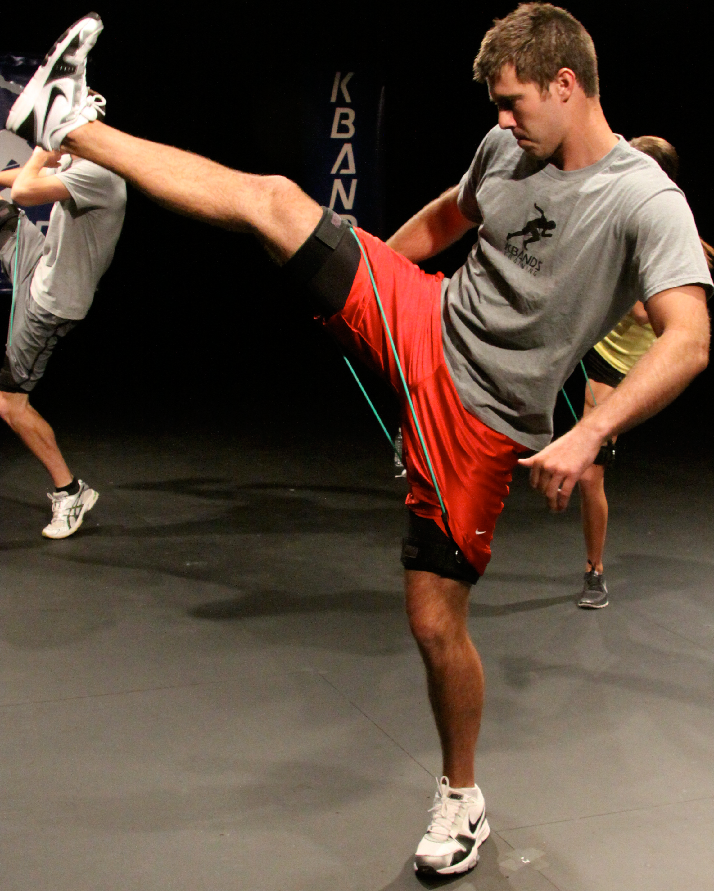 guy-high-leg-kick-with-bands.png