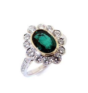 Oval Emerald & Diamond Cluster Ring  (Prices from £5950.00)
