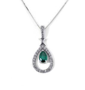 Pear Cut Emerald 'Floating' in Diamond Surround