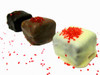 Raspberry:Ganache infused with natural raspberry infusion. Topped with edible glitter.Hand-dipped in milk, dark or white chocolate