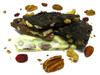 Cranberry Nut Bark: Pecans, dry roasted almonds, golden raisins, cranberries, raw pumpkin seeds and chocolate.  It almost sounds like health food. Available in milk or dark chocolate.
