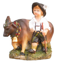 German boy with cow magnet