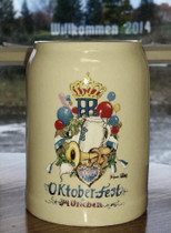 "Ceramic German Beer Mug 0.5L 2014 This beer mug is Kilm fired ceramic. It features a HB mug, a horn, pretzel, and lebkuchen hart , the Hofbrau crest and the words ""Oktoberfest Munchen""."