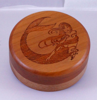 Diameter: 3 1/2 inches  This box is excellent for small awards and promotions. Made for smaller items. You can also get a heart shaped box like above. Includes a felt lining and is stocked in cherry and walnut is available.