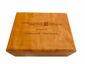 Our Personalized Boxes are crafted in the United States from finely finished cherry wood. This personalized hinged-box is designed to hold a variety of items such as candy, jewelry, business cards, pens or golf balls. This interior of the box includes felt lining. Great for promotions, awards or recognition.