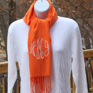 University of Tennessee orange scarf monogrammed with white initials in the monogram script font.