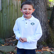 Monogrammed boy's white long sleeve polo shirt personalized with green thread in the Monogram 1 font.